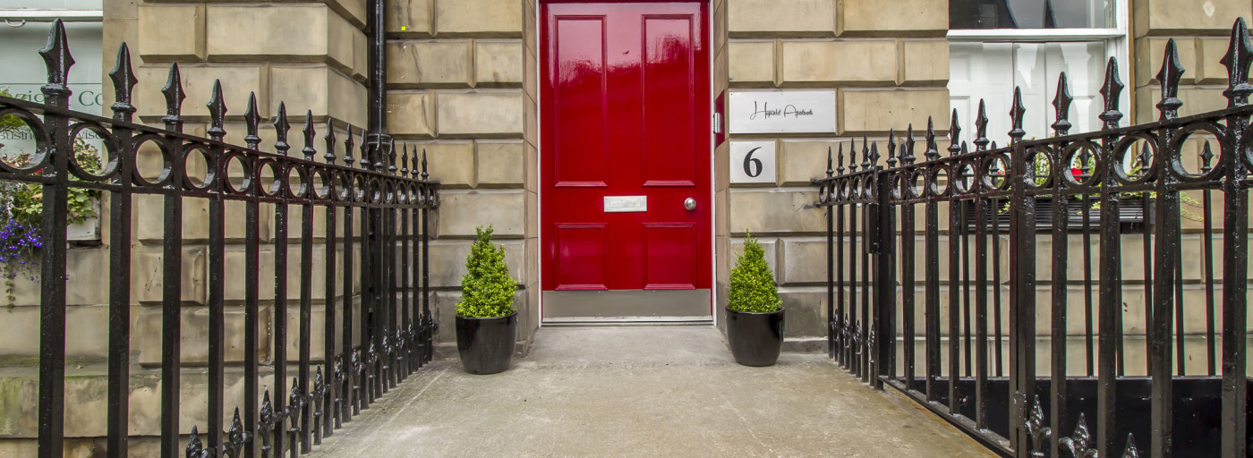 The iconic red front door of Haymarket Apartments