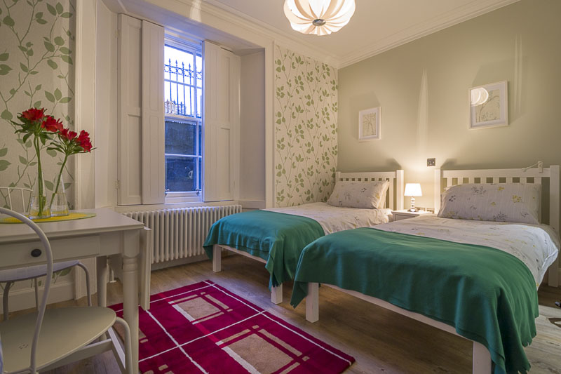 Room 1 - A quaint and lovely space with two single beds