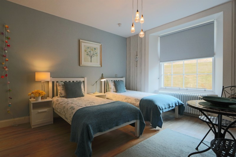 Two single beds in Room 2